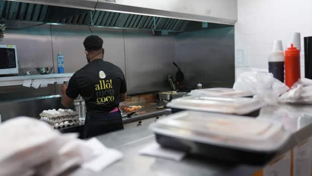 A worker prepares takeout orders at the Allô! Mon Coco restaurant in Gatineau, Que., on May 30, 2021. As of Monday, indoor dining be allowed to resume at restaurants in western Quebec.