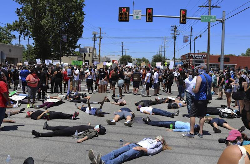 People lie down on Interstate 44 in Tulsa during a demonstration sparked by the death of George Floyd.