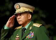 FILE PHOTO: Myanmar Commander in Chief Senior General Min Aung Hlaing salutes as he attends an event marking the anniversary of Martyrs' Day at the Martyrs' Mausoleum in Yangon