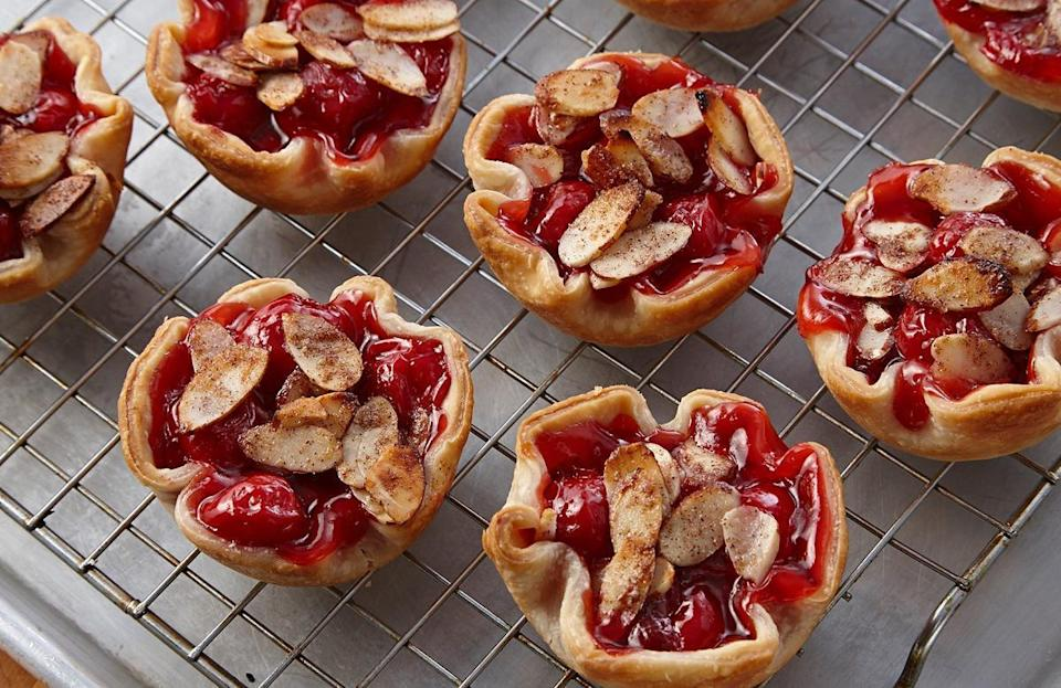 """<p>The labor of baking a whole pie is now a thing of the past thanks to this recipe for mini cherry pies. They can be <a href=""""https://www.thedailymeal.com/cook/7-recipes-aren-t-pie-using-refrigerated-pie-crust?referrer=yahoo&category=beauty_food&include_utm=1&utm_medium=referral&utm_source=yahoo&utm_campaign=feed"""" rel=""""nofollow noopener"""" target=""""_blank"""" data-ylk=""""slk:made with refrigerated pie crust"""" class=""""link rapid-noclick-resp"""">made with refrigerated pie crust</a>, which is cut into six small rounds and pressed into a muffin pan. Then, simply divide a mixture of cherry pie filling and almond extract evenly among the crusts.</p> <p><a href=""""https://www.thedailymeal.com/recipes/easy-mini-cherry-pies-recipe?referrer=yahoo&category=beauty_food&include_utm=1&utm_medium=referral&utm_source=yahoo&utm_campaign=feed"""" rel=""""nofollow noopener"""" target=""""_blank"""" data-ylk=""""slk:For the Mini Cherry Pies recipe, click here"""" class=""""link rapid-noclick-resp"""">For the Mini Cherry Pies recipe, click here</a>.</p>"""