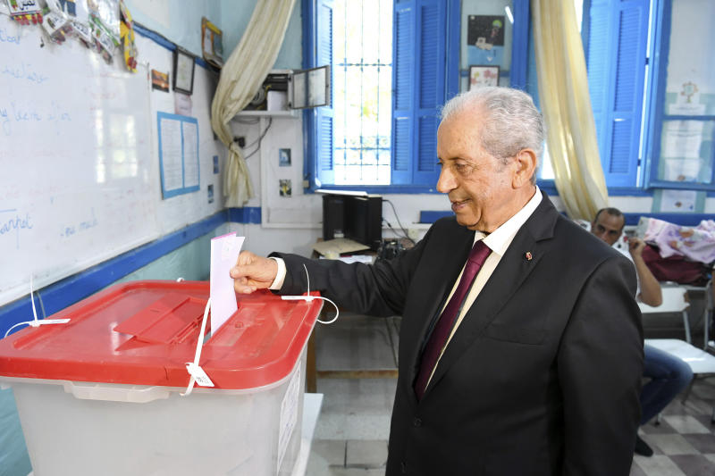 In this photo provided by the Tunisian Presidency, Tunisian President Mohamed Ennaceur casts his ballot in a class room used as a polling station during the first round of the presidential election, in Sidi Bou Said, north of Tunis, Tunisia, Sunday Sept. 15, 2019. Tunisians are casting ballots in their North African country's second democratic presidential election, choosing among 26 candidates for a leader who can safeguard its young democracy and tackle its unemployment, corruption and economic despair. (Slim Abid/Tunisian Presidency via AP)