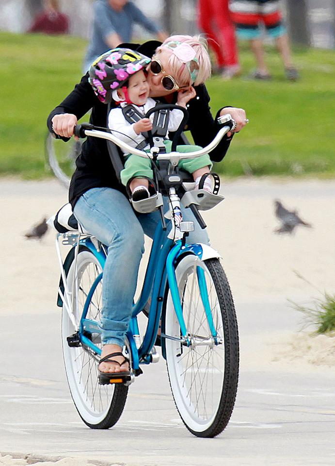 Celebrating her very first Mother's Day, Pink planted a big smooch on her daughter Willow's cheek during a beachfront bike ride in Los Angeles. Also along for the ride? Pink's hubby Carey Hart. (5/13/2012)