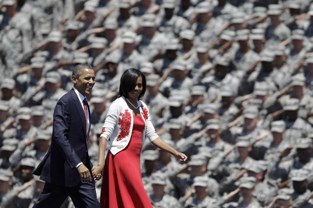 <p>President Barack Obama and first lady Michelle are saluted by soldiers as they arrive at the Fort Stewart Army post, April 27, 2012, in Fort Stewart, Ga. (AP Photo/David Goldman) </p>