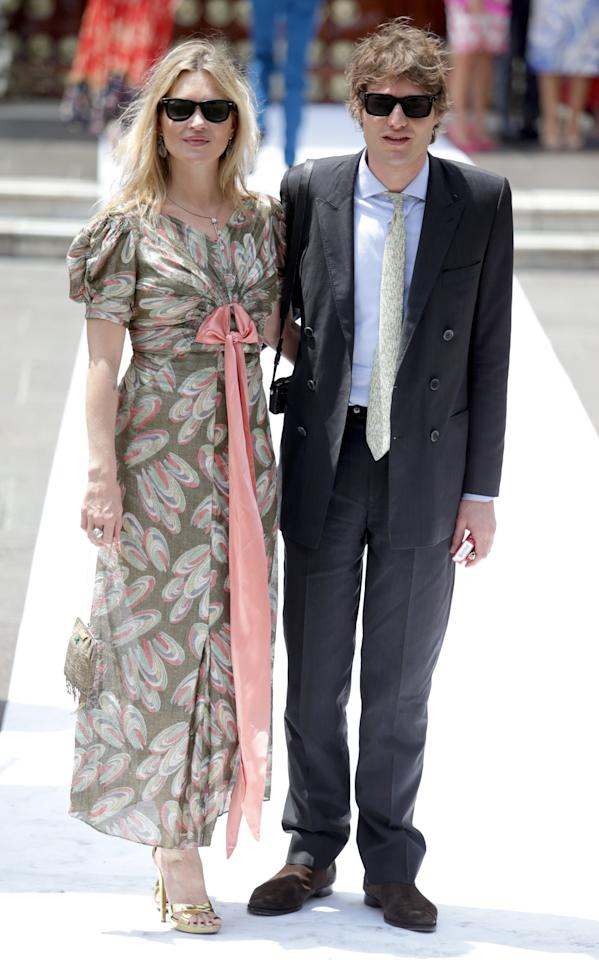<p>Attending the wedding of European royalty Prince Christian of Hanover and Alessandra de Osma in Peru, Kate Moss kept it playful in a peacock print dress complete with a pink bow. Wedding guest attire nailed. [Photo: Getty] </p>
