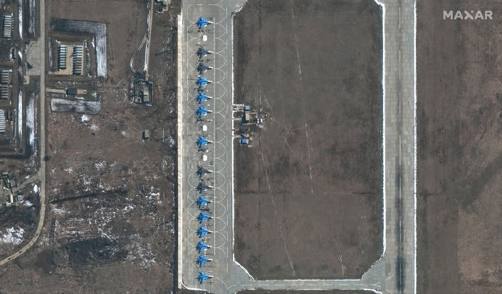 This image provided by Maxar Technologies shows 11 SU-34 aircrafts at Morozovsk airbase in Russia, on Saturday, March 27, 2021. Russia has insisted that it has the right to restrict foreign naval ships' movement off Crimea, rejecting Ukrainian complaints and Western criticism. Ukraine last week protested the Russian move to close broad areas of the Black Sea near Crimea to foreign navy ships and state vessels until November. (Satellite image ©2021 Maxar Technologies via AP)