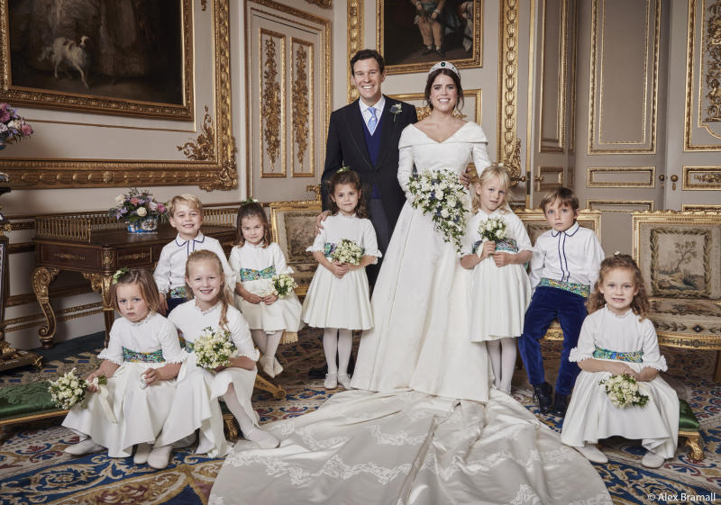 The newlyweds pose with their pages and bridesmaids. Prince George smiles in the back row with his sister, Princess Charlotte. Brooksbank rests his hand on the shoulder of Theodora Williams, daughter of singer Robbie Williams and Ayda Field. (Alex Bramall/Courtesy Buckingham Palace)