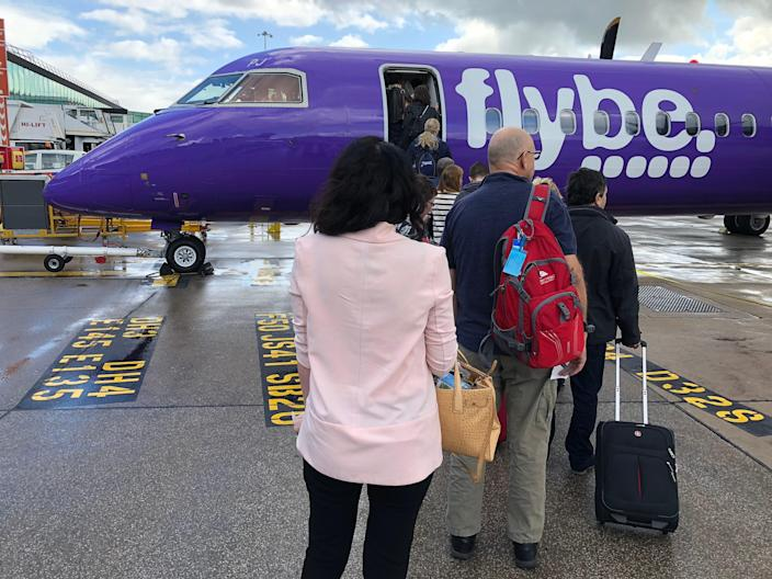Airborne again? Passengers boarding a Flybe aircraft at Manchester airport before the airline collapsed in March 2020 (Simon Calder)
