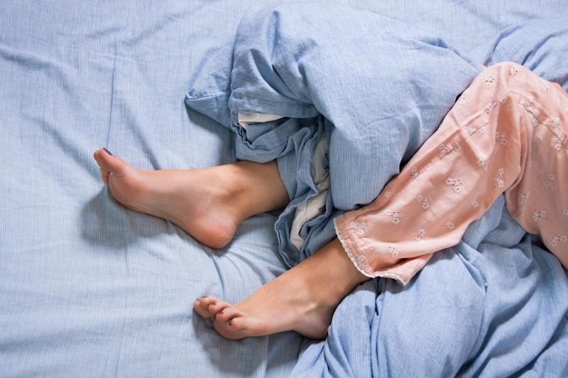 Why do we still insist on hugging our duvet even in the heat? [Photo: Getty]