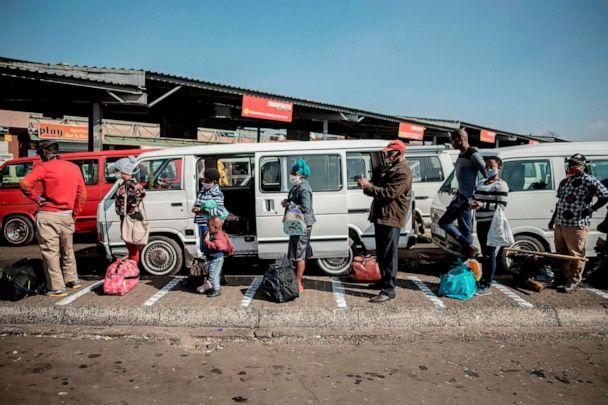 PHOTO: Commuters adhere to physical distancing measures while queueing at the Germiston Taxi Rank near Johannesburg, South Africa, on May 7, 2020. (Luca Sola/AFP via Getty Images)