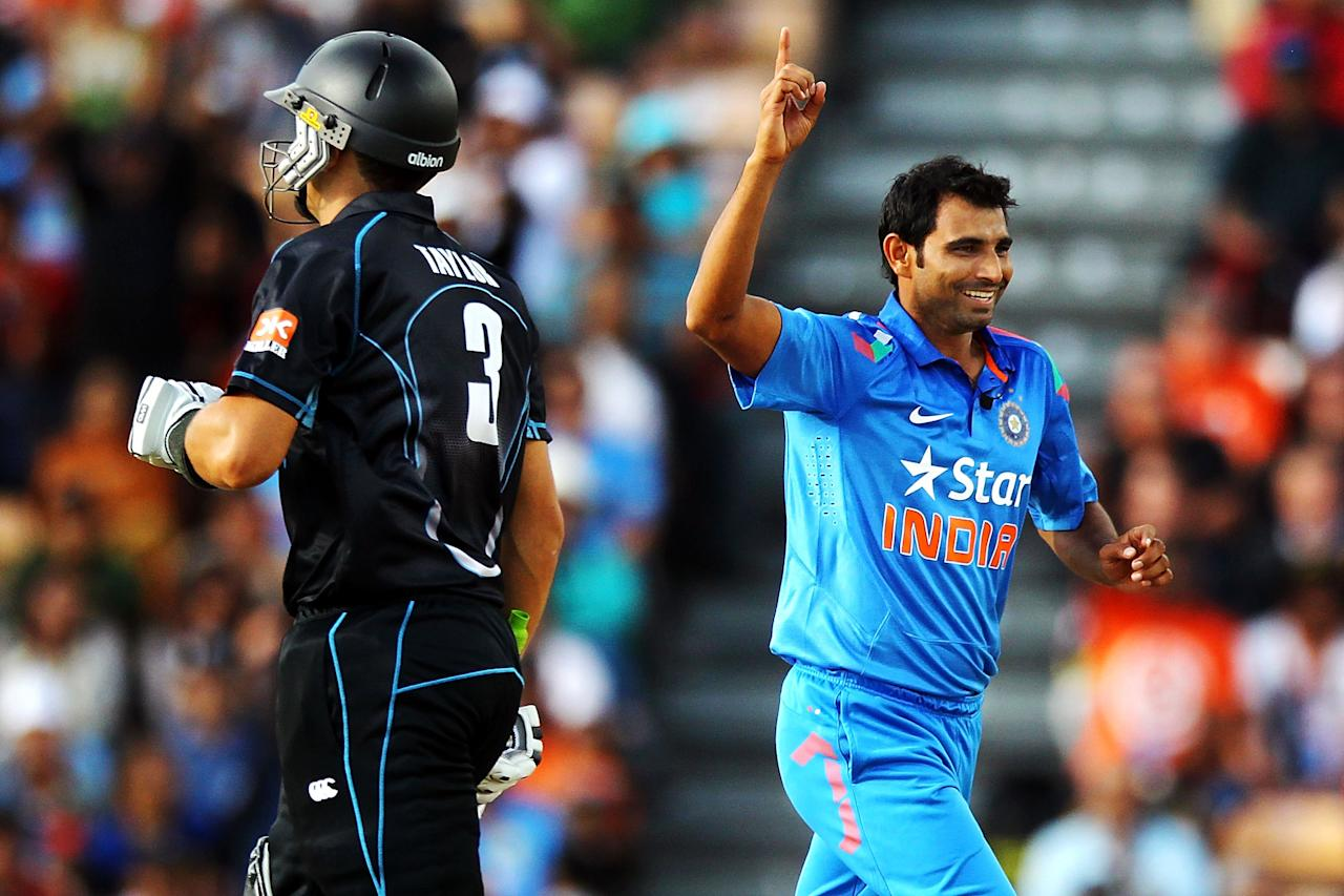 HAMILTON, NEW ZEALAND - JANUARY 22:  Mohammed Shami of India celebrates after taking the wicket of Ross Taylor of New Zealand during the One Day International match between New Zealand and India at Seddon Park on January 22, 2014 in Hamilton, New Zealand.  (Photo by Anthony Au-Yeung/Getty Images)