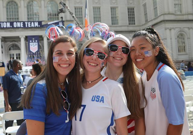 """Soccer fans line the parade route as members of the United States Women's National Soccer Team are honored at a ceremony at City Hall on July 10, 2019 in New York City. The honor followed a ticker tape parade up lower Manhattan's """"Canyon of Heroes"""" to celebrate their gold medal victory in the 2019 Women's World Cup in France. (Photo by Bruce Bennett/Getty Images)"""