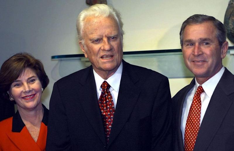 He was also known at the 'President's Preacher'. Here he is with George Bush. Photo: Getty Images