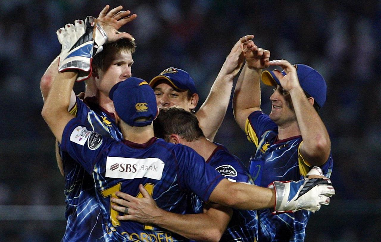 Otago Volts players celebrate the fall of a wicket during the CLT20 match between Rajasthan Royals and Otago Volts at Sawai Mansingh Stadium in Jaipur on Oct. 1, 2013. (Photo: IANS)