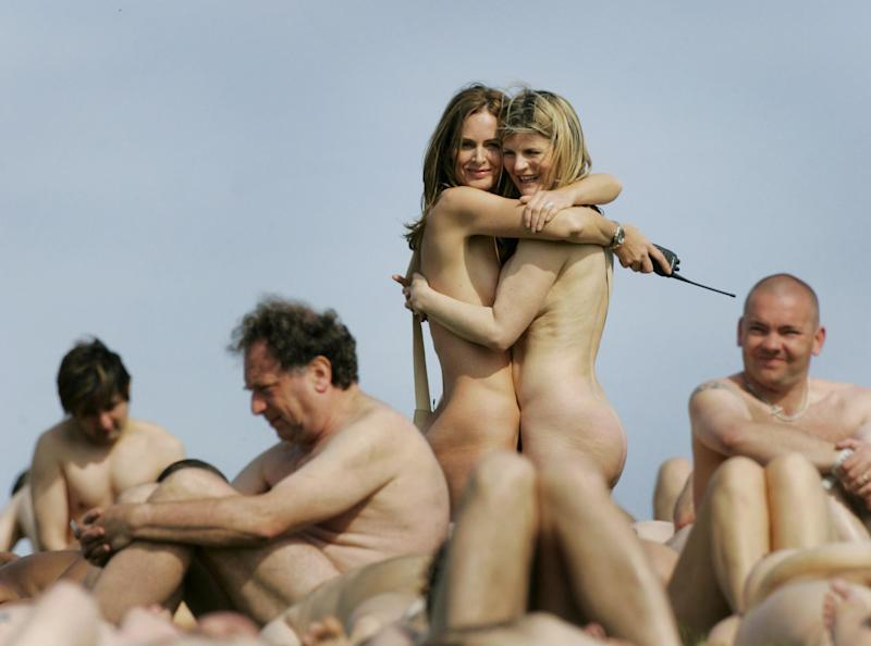 NOTE CONTENT. Fashion experts Trinny Woodall (left) and Susannah Constantine pose naked, joined by hundreds of volunteers to celebrate the country's finest forms by creating a living sculpture on the side of a hill near Lewes, Sussex.