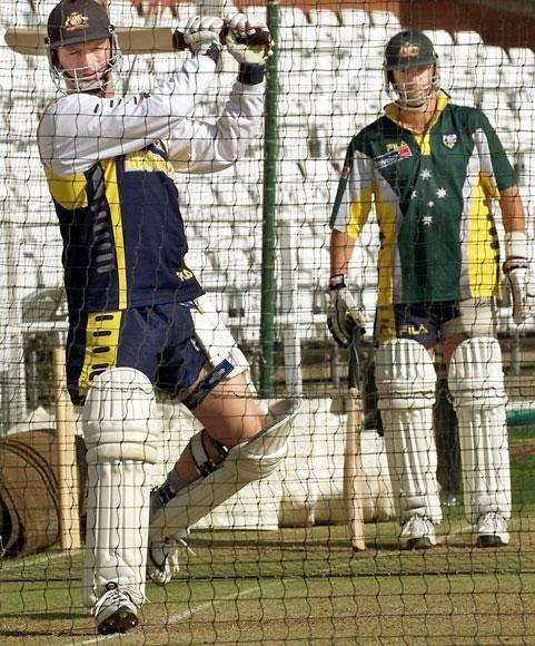 Australian captain Steve Waugh (L) cracks a ball through point as brother Mark Waugh (R) looks on during training at Trent Bridge in Nottingham on the eve of the third Test Match against England 01 August 2001. Australia go into the test firm favourites after defeating England in the first two tests.   AFP PHOTO/WILLIAM WEST