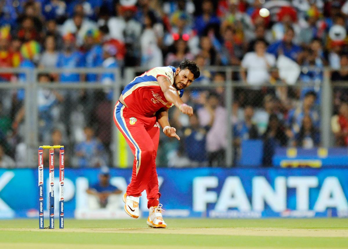 Ravi Rampaul of Royal Challengers Bangalore bowls during match 37 of the Pepsi Indian Premier League ( IPL) 2013  between The Mumbai Indians and the Royal Challengers Bangalore held at the Wankhede Stadium in Mumbai on the 27th April 2013. (BCCI)