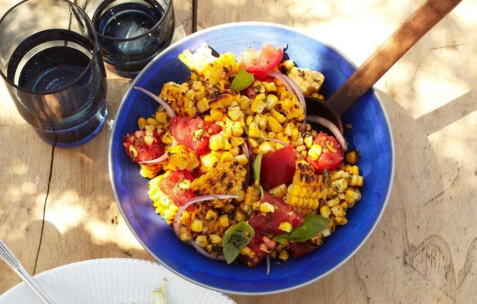 """If making ahead, don't add the basil until just before serving. <a href=""""https://www.bonappetit.com/recipe/charred-corn-salad-with-basil-and-tomatoes?mbid=synd_yahoo_rss"""" rel=""""nofollow noopener"""" target=""""_blank"""" data-ylk=""""slk:See recipe."""" class=""""link rapid-noclick-resp"""">See recipe.</a>"""