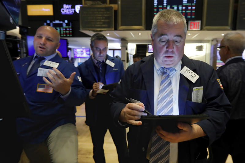 Trader Edward McCarthy, right, works on the floor of the New York Stock Exchange, Friday, Nov. 15, 2019. Stocks are opening broadly higher on Wall Street as hopes continued to grow that the U.S. and China were moving closer to a deal on trade. (AP Photo/Richard Drew)