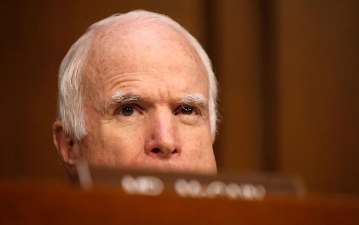 Sen. John McCain (R-Ariz.), who is not on the committee, watches as Comey testifies.