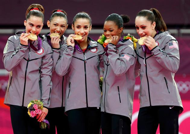 LONDON, ENGLAND - JULY 31:  Mc Kayla Maroney, Kyla Ross, Alexandra Raisman, Gabrielle Douglas and Jordyn Wieber of the United States celebrate after winning the gold medal in the Artistic Gymnastics Women's Team final on Day 4 of the London 2012 Olympic Games at North Greenwich Arena on July 31, 2012 in London, England.  (Photo by Jamie Squire/Getty Images)
