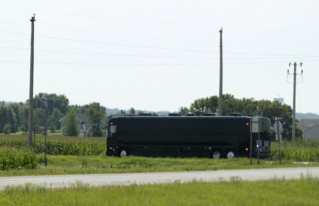 President Barack Obama's bus drives past corn fields to Lower Hannah's Bend Park, Monday, Aug. 15, 2011, in Cannon Falls, Minn., during his three-day economic bus tour. (AP Photo/Carolyn Kaster)