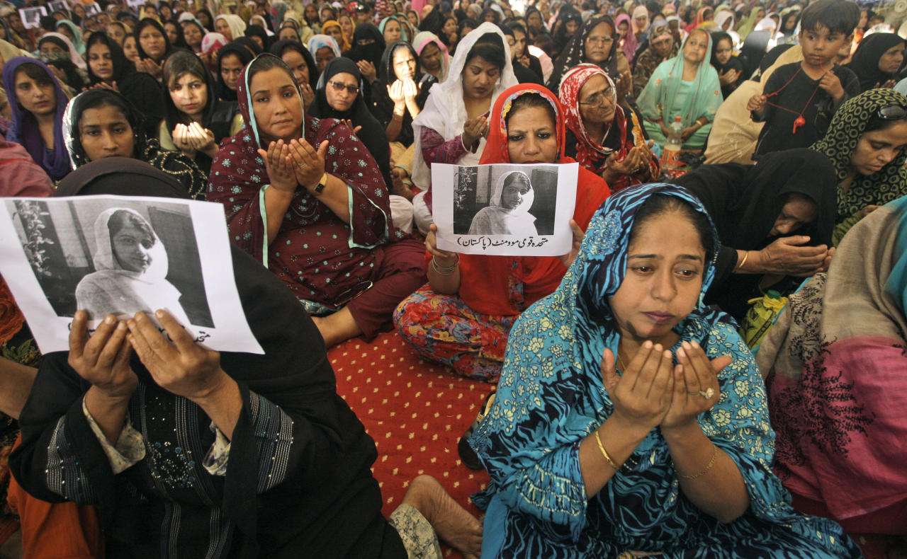 "Supporters of Pakistani political party Muttahida Qaumi Movement (MQM), chant prayers in support of 14-year-old schoolgirl Malala Yousufzai, who was shot on Tuesday by the Taliban for speaking out in support of education for women, at the (MQM)' headquarter in Karachi, Pakistan, Wednesday, Oct. 10, 2012. Pakistani doctors successfully removed a bullet Wednesday from the neck of a 14-year-old girl who was shot by the Taliban for speaking out in support of education for women, a government minister said. Writing on the poster under Malala's picture read, "" Muttahida Qaumi Movement, Pakistan.""(AP Photo/Shakil Adil)"