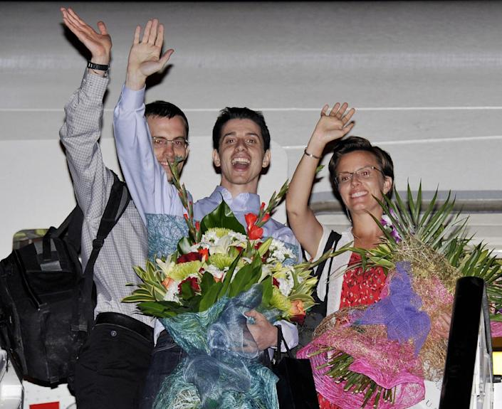 FILE - In this Sept. 24, 2011, file photo, Shane Bauer, left, Josh Fattal, center, and Sarah Shourd, right, Bauer's fiance, wave before leaving for the United States at the airport in Muscat, Oman. Oman, the Gulf state that helped mediate their release after more than two years in custody on accusations of spying. Oman's Sultan Qaboos was a key player in facilitating the release of three American hikers who were detained when they strayed across the Iraq boarder into Iran. Qaboos then offered himself as a mediator for a U.S.-Iran rapprochement, starting the secret informal discussion between Washington and Tehran. The U.S. and Iran secretly engaged in high-level, face-to-face talks, at least three times over the past year, in a high stakes diplomatic gamble by the administration that paved the way for the historic deal aimed at slowing Iran's nuclear program. (AP Photo/Sultan al-Hasani, File)