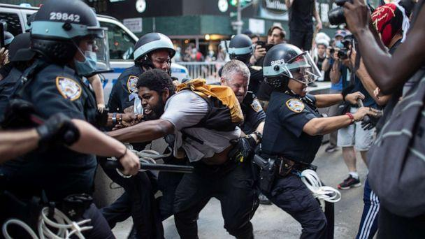 PHOTO: Police detain protesters in New York during nationwide demonstations over the death of George Floyd, May 30, 2020. (Wong Maye-E/AP)