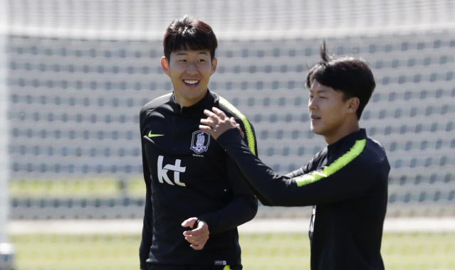 South Korea's Son Heung-min, left, smiles next to LeeSeung-woo during a training session of South Korea at the 2018 soccer World Cup at the Spartak Stadium in Lomonosov near St. Petersburg, Russia, Thursday, June 14, 2018. (AP Photo/Lee Jin-man)