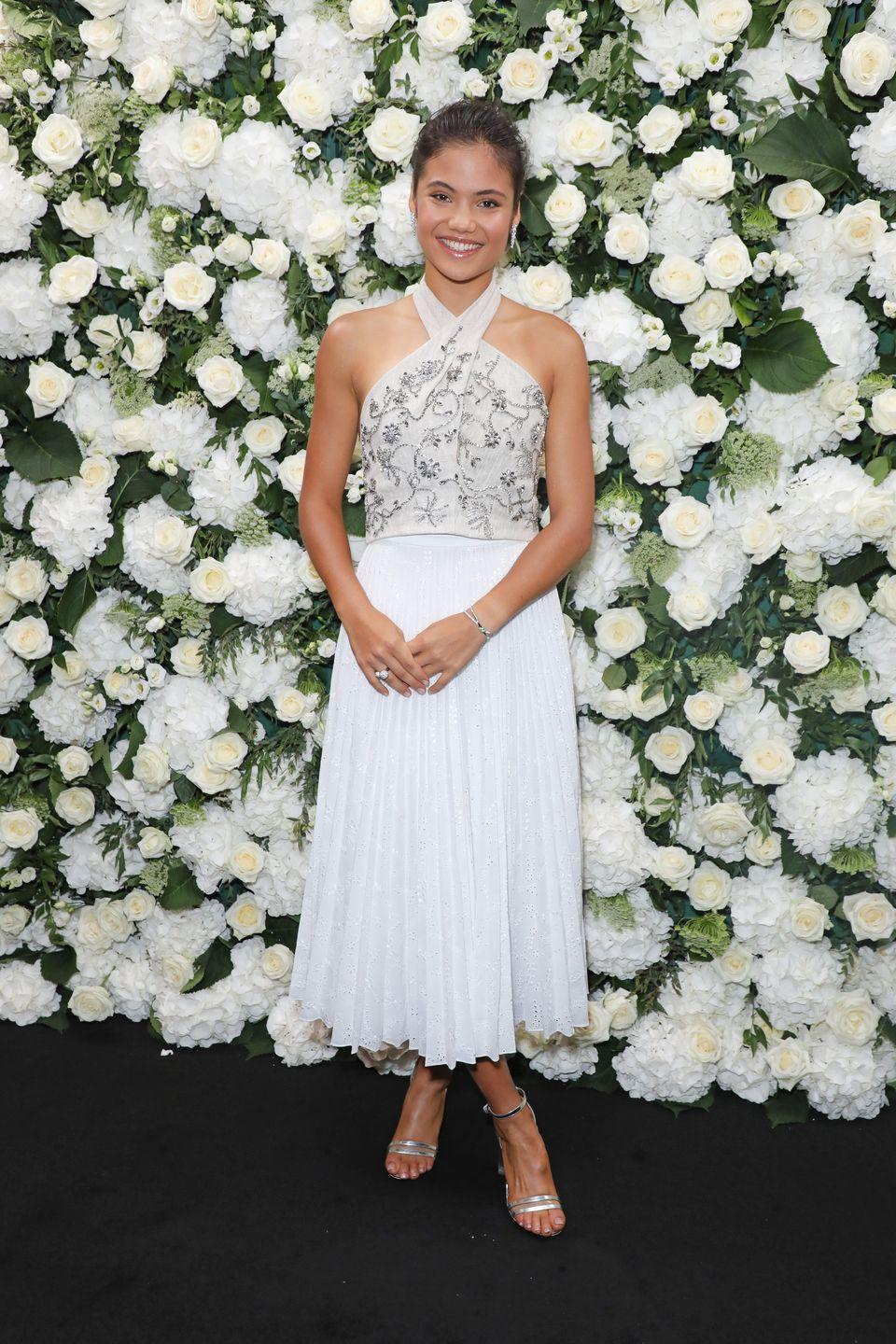 <p>Raducanu wore a pair of silver heels and a white and cream-coloured halterneck midi dress to a Tiffany & Co. event in London. </p>