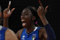 Italy's Paola Ogechi Egonu celebrates winning a point during the women's volleyball preliminary round pool B match between United States and Italy at the 2020 Summer Olympics, Monday, Aug. 2, 2021, in Tokyo, Japan. (AP Photo/Frank Augstein)