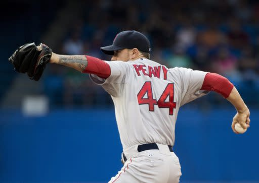 Boston Red Sox starting pitcher Jake Peavy works against the Toronto Blue Jays during the first inning of a baseball game, Tuesday, July 22, 2014 in Toronto. (AP Photo/The Canadian Press, Nathan Denette)