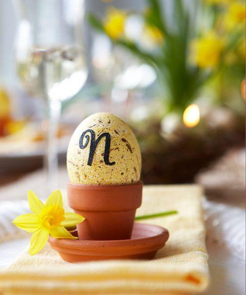 """<p>Try this clever alternative for place cards — eggs adorned with guests' initials. Dye hard-cooked eggs pale yellow, then create a speckled effect using diluted brown acrylic paint. Let dry, affix scrapbook letter stickers, and adorn with a silk daffodil (actual daffodil sap is poisonous). You can also use pre-speckled pastel craft eggs. </p><p><a class=""""link rapid-noclick-resp"""" href=""""https://www.amazon.com/Package-Speckles-Decorating-Crafting-Creating/dp/B00J2XEGJW/?tag=syn-yahoo-20&ascsubtag=%5Bartid%7C10055.g.2217%5Bsrc%7Cyahoo-us"""" rel=""""nofollow noopener"""" target=""""_blank"""" data-ylk=""""slk:BUY CRAFT EGGS"""">BUY CRAFT EGGS</a><br></p>"""