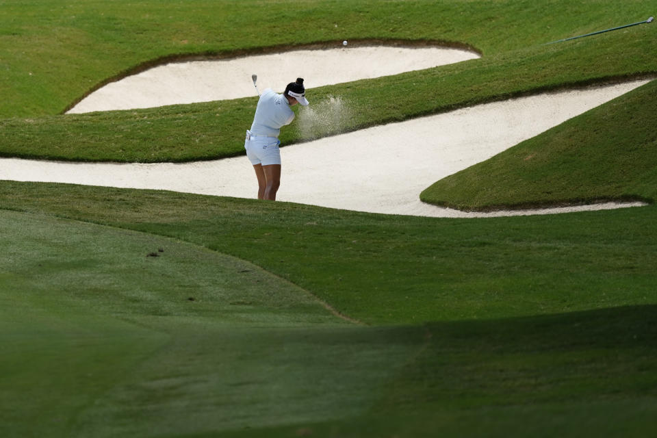 Patty Tavatanakit of Thailand hits toward the green on the second hole, during the final round of play in the KPMG Women's PGA Championship golf tournament Sunday, June 27, 2021, in Johns Creek, Ga. (AP Photo/John Bazemore)