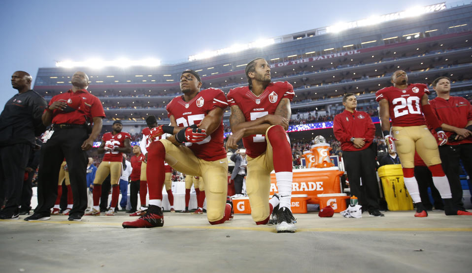 SANTA CLARA, CA - SEPTEMBER 12: Eric Reid #35 and Colin Kaepernick #7 of the San Francisco 49ers kneel during the anthem, prior to the game against the Los Angeles Rams at Levi Stadium on September 12, 2016 in Santa Clara, California. The 49ers defeated the Rams 28-0. (Photo by Michael Zagaris/San Francisco 49ers/Getty Images)