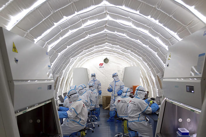 Staffers at Chinese biotech company work in an inflatable Covid-19 testing lab in Beijing.