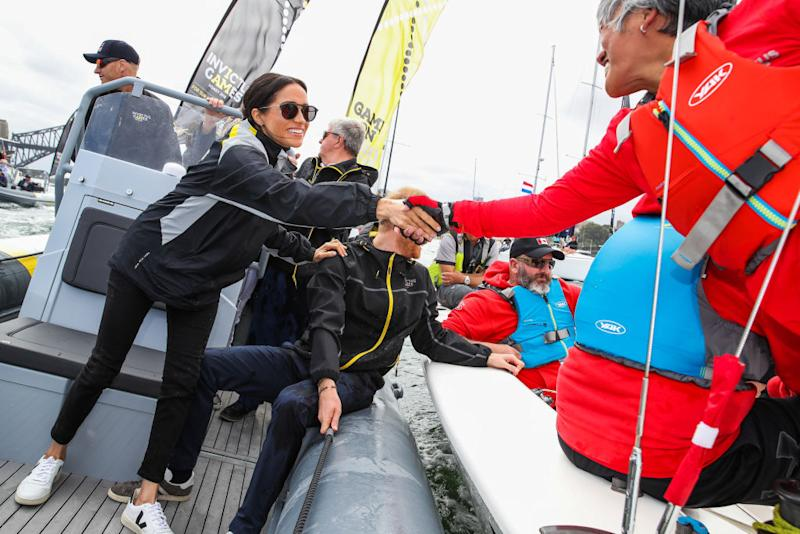 Meghan Markle, Duchess of Sussex, and Prince Harry, Duke of Sussex sail across Sydney harbor at Sydney Olympic Park on October 21, 2018 in Sydney, Australia. (Photo: Pool/Samir Hussein/WireImage)