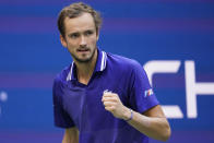 Daniil Medvedev, of Russia, reacts after scoring a point against Felix Auger-Aliassime, of Canada, during the semifinals of the US Open tennis championships, Friday, Sept. 10, 2021, in New York. (AP Photo/John Minchillo)