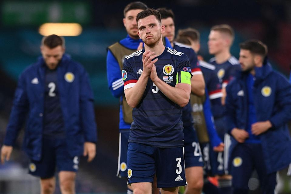 Captain Andy Robertson with his beaten Scotland teammates (POOL/AFP via Getty Images)