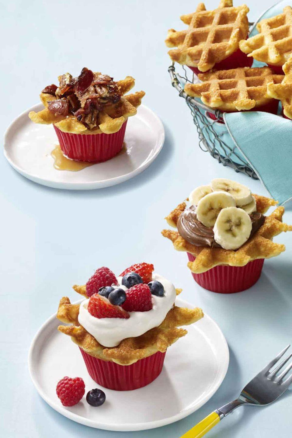 """<p>Customize these delightful breakfast cupcakes with your mom's favorite toppings and fruit.</p><p><strong><em><a href=""""https://www.womansday.com/food-recipes/food-drinks/recipes/a57925/wafflecakes-recipe/"""" rel=""""nofollow noopener"""" target=""""_blank"""" data-ylk=""""slk:Get the Wafflecakes recipe."""" class=""""link rapid-noclick-resp"""">Get the Wafflecakes recipe.</a> </em></strong><br></p>"""