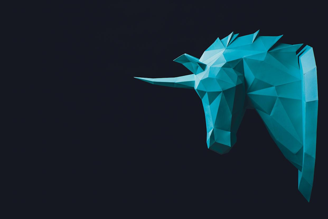 Unicorn turquoise head paper isolated on black background. Copy space