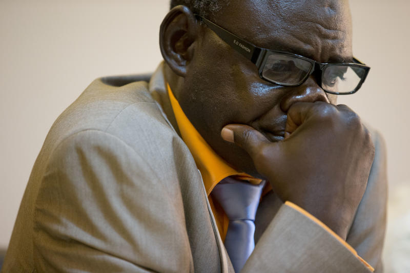 Clement Abaifouta, president of the association of victims of former Chadian dictator Hissene Habre, reacts as he listens to fellow victims recount their stories, at a press conference in Dakar, Senegal, Wednesday, July 17, 2013. Abaifouta, arrested in 1985, said he was forced for four years to dig graves for hundreds of prisoners, while his health deteriorated to the point where he was no longer able to walk. A lawyer said more than 1,000 victims of Habre have formally asked to participate in his trial on charges of war crimes, crimes against humanity and torture. (AP Photo/Rebecca Blackwell)