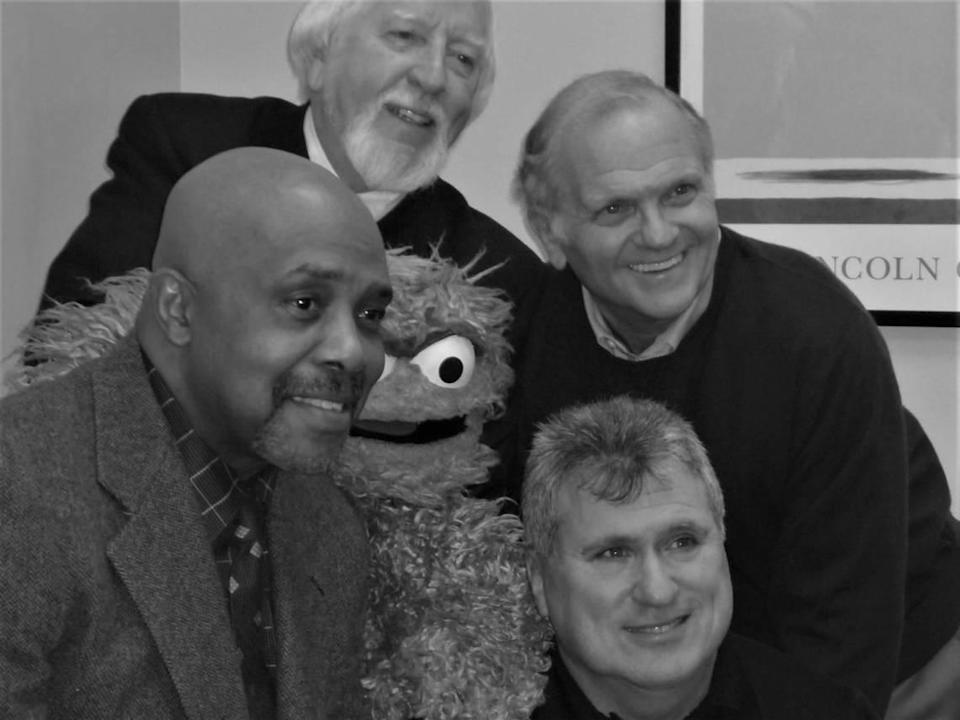 """Michael Davis (bottom right), photographed in 2019 at the Barnes & Noble bookstore near Lincoln Center Manhattan with Carroll Spinney (top left); """"Sesame Street"""" composer Christopher Cerf (top right); Roscoe Orman (who played Gordon on """"Sesame Street"""" for more than four decades); and Oscar the Grouch."""
