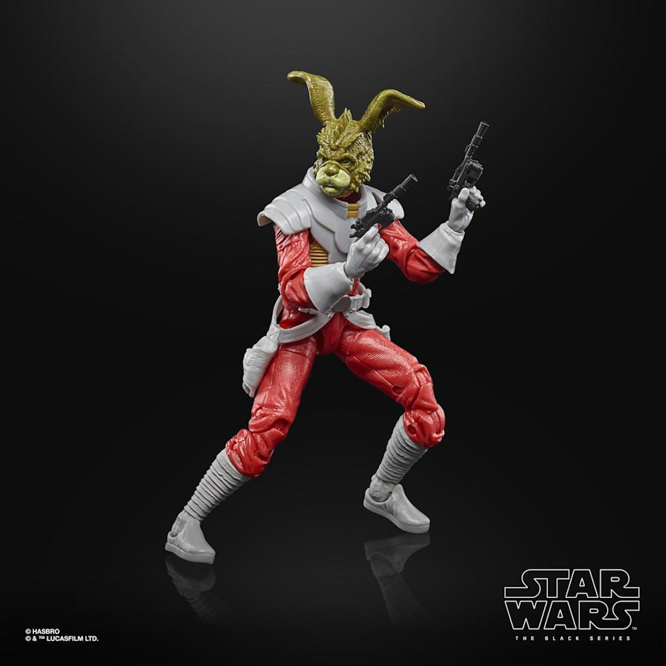A Jaxxon Rabbit Hasbro Star Wars Black Series figure, out of the box and holding two blasters