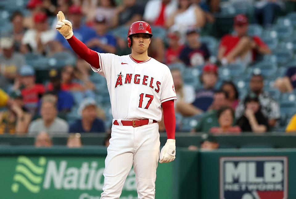 ANAHEIM, CALIFORNIA - JULY 29:  Shohei Ohtani #17 of the Los Angeles Angels leads off first base against the Oakland Athletics in the third inning at Angel Stadium of Anaheim on July 29, 2021 in Anaheim, California. (Photo by Ronald Martinez/Getty Images)