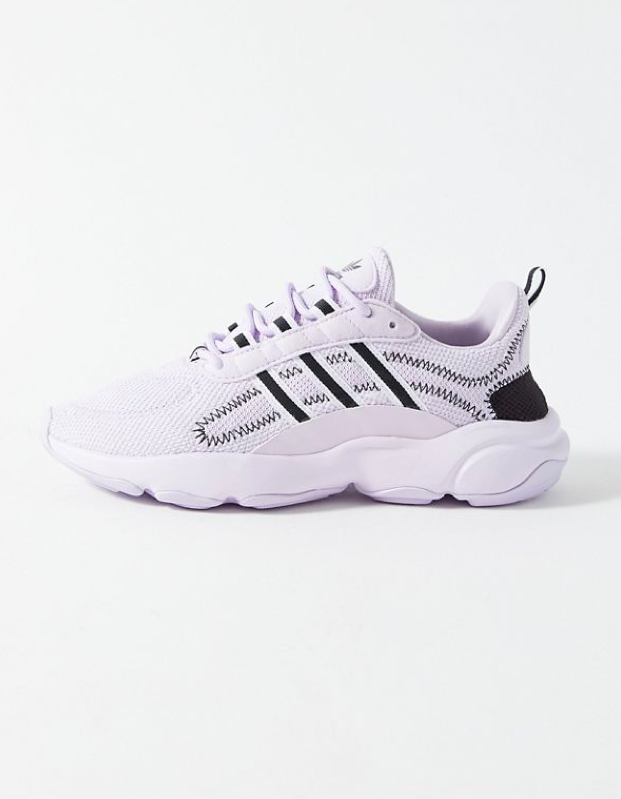 "$85, Urban Outfitters. <a href=""https://www.urbanoutfitters.com/shop/adidas-haiwee-lilac-sneaker"">Get it now!</a>"