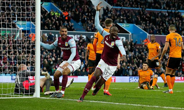 Albert Adomah turns away from the Wolves goal having scored Aston Villa's opener in the eighth minute.