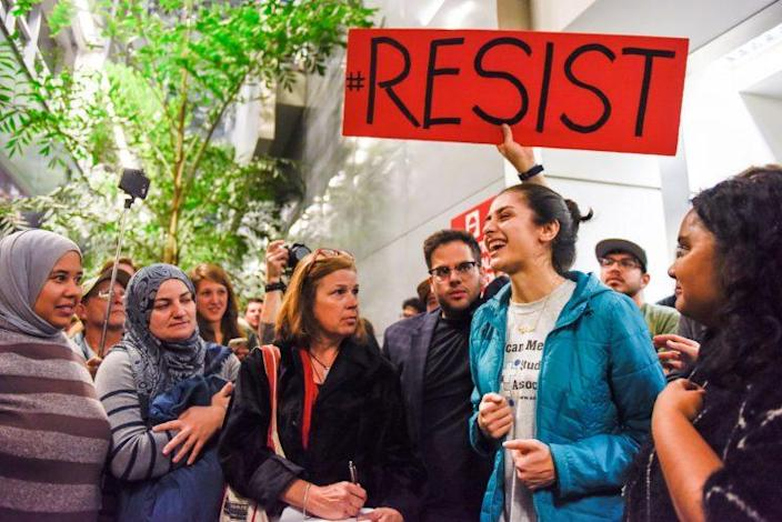 Niloofar Radgoudarzi thanking the crowd for protesting after her father was released from custody after being detained in San Francisco International Airport. (Photo: Kate Munsch/Reuters)