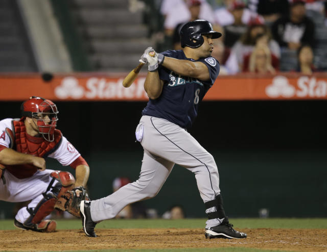 Seattle Mariners' Kendrys Morales hits a RBI single against the Los Angeles Angels during the 10th inning of a baseball game in Anaheim, Calif., Tuesday, June 18, 2013. (AP Photo/Jae C. Hong)