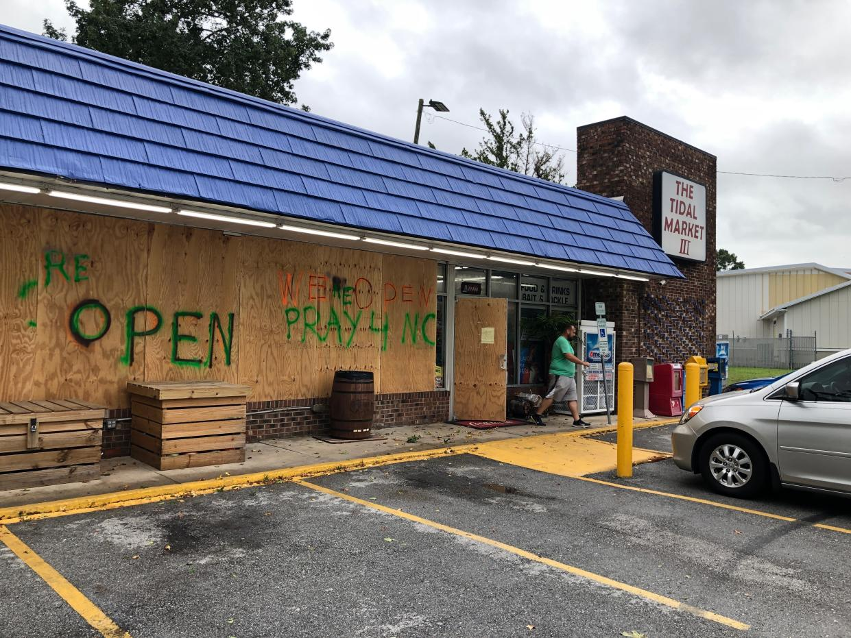 A customer walks out of The Tidal Market III convenience store in Wilmington, N.C, on Sept. 5, 2019. Hurricane Dorian was expected to brush just off the coast of the area. (Photo: Jeffrey Collins/AP)